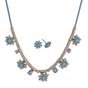 "Aqua cord necklace set with aqua flowers and gold tone beads. Approximately 24"" in length."