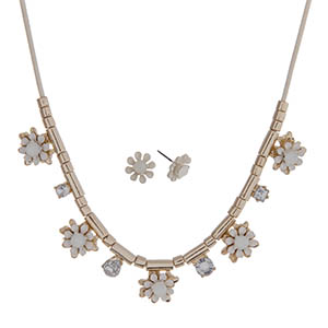 "Ivory cord necklace set with ivory flowers and gold tone beads. Approximately 24"" in length."