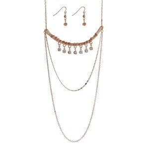 "Gold tone bar necklace set with champagne colored beads and clear rhinestone accents. Approximately 30"" in length."