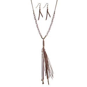 "Gold tone necklace set with pink beads and a 6"" suede and feather tassel. Approximately 32"" in length."