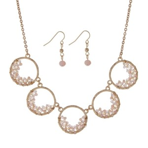 "Gold tone necklace set displaying five circles with pale pink wire wrapped beads. Approximately 18"" in length."