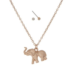 "Dainty gold tone necklace set featuring an elephant pendant. Approximately 18"" in length."