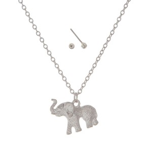 "Dainty silver tone necklace set featuring an elephant pendant. Approximately 18"" in length."