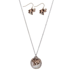 "Silver tone necklace set with a two tone elephant pendant. Approximately 16"" in length."