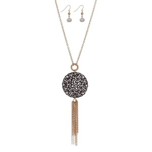 """Gold tone necklace set with a gray wooden filigree circle pendant and chain tassel. Approximately 32"""" in length."""