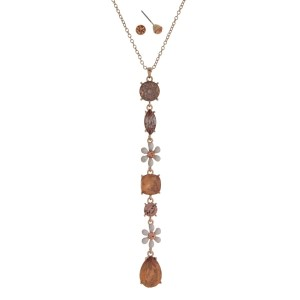 "Gold tone necklace set with a flower and pink opal rhinestone pendant. Approximately 32"" in length."