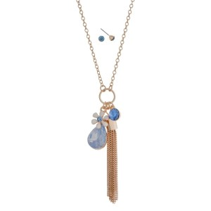 "Gold tone dainty necklace set with blue opal, tassel and rhinestone charms. Approximately 24"" in length."