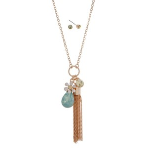 "Gold tone dainty necklace set with mint green opal, tassel and rhinestone charms. Approximately 24"" in length."