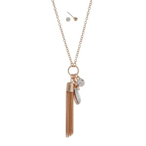 "Gold tone dainty necklace with white opal, tassel and rhinestone charms. Approximately 24"" in length."