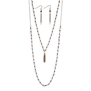 "Dainty gold tone double layer necklace set with gray and black beads accented with a chain tassel. Approximately 26"" in length."
