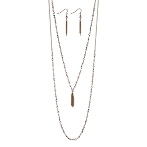 "Dainty gold tone double layer necklace set with light pink and blue beads accented with a chain tassel. Approximately 26"" in length."