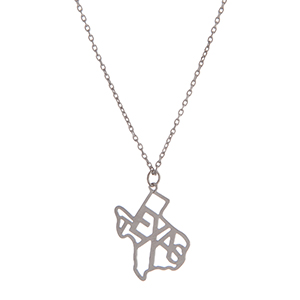 "Dainty silver tone necklace featuring the state of Texas pendant. Approximately 18"" in length."