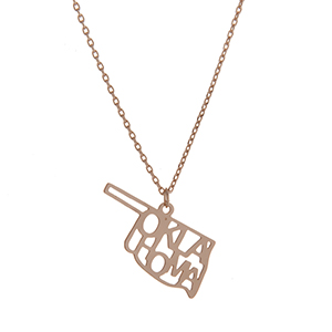 "Dainty gold tone necklace featuring the state of Oklahoma pendant. Approximately 18"" in length."