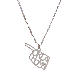 "Dainty silver tone necklace featuring the state of Oklahoma pendant. Approximately 18"" in length."
