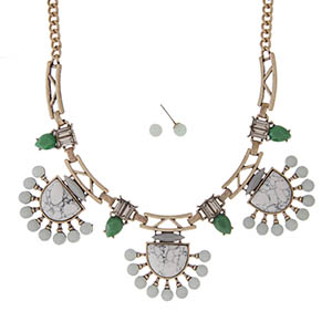 "Gold tone necklace set with howlite and mint green stones accented with green and clear rhinestones. Approximately 18"" in length."