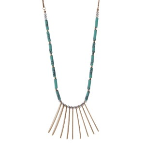 "Gold tone necklace featuring metal fringe, accented with turquoise and iridescent beads. Approximately 32"" in length."