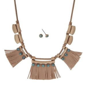"Burnished gold tone necklace set with tan leather fringe and turquoise stones. Approximately 18"" in length."