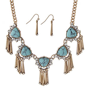 "Burnished gold tone necklace set with turquoise stones, clear rhinestones, and metal fringe. Approximately 18"" in length."