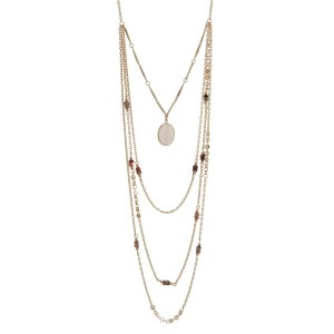 "Gold tone multi-layer necklace with a white opal natural stone pendant accented with natural color beads. Approximately 32"" in length."