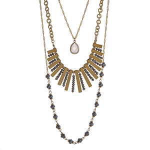 "Gold tone triple layer necklace with faceted gray glass beads and a white opal teardrop pendant. Approximately 30"" in length."