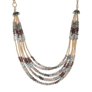 """Gold tone necklace featuring multiple rows of brown and green beads with gold hardware. Approximately 16"""" in length."""