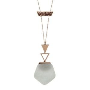 """Burnished gold tone necklace with a hexagonal light blue natural stone pendant. Approximately 30"""" in length."""