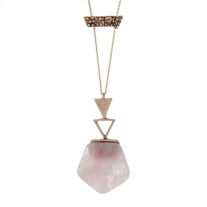 "Dainty gold tone necklace with a rose quartz natural stone hexagon pendant with burnished gold tone hardware. Approximately 32"" in length."