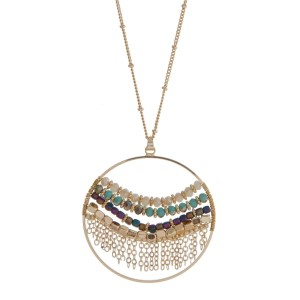 """Gold tone necklace with an ivory and turquoise beaded circle pendant. Approximately 32"""" in length."""