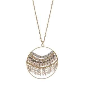 """Gold tone necklace with an ivory and gray beaded circle pendant. Approximately 32"""" in length."""