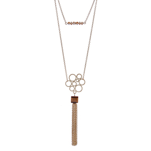 "Dainty gold tone double layer necklace with brown beads and a natural stone pendant with a chain tassel. Approximately 36"" in length."