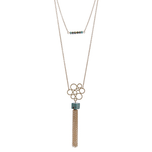 "Dainty gold tone double layer necklace with turquoise beads and a natural stone pendant with a chain tassel. Approximately 36"" in length."