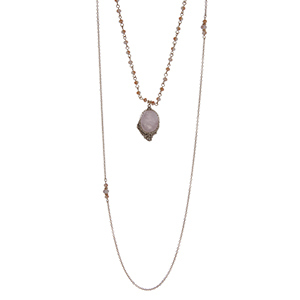 "Gold tone double layer necklace with a rose quartz natural stone pendant accented with pink beads. Approximately 32"" in length."
