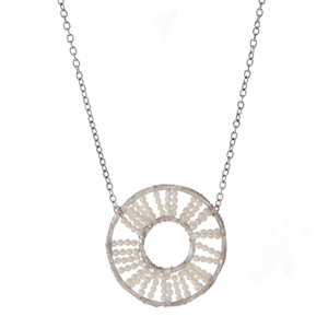 "Silver tone necklace with a wire wrapped circle pendant with white pearl beads. Approximately 32"" in length."