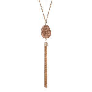 "Gold tone necklace with a peach pave rhinestone pendant and metal tassel. Approximately 36"" in length."