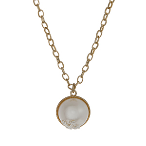 "Gold tone necklace set with a white pearl pendant accented with a silver tone cross. Approximately 16"" in length."