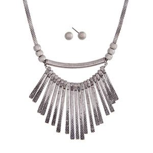 "Silver tone necklace set with hammered metal fringe. Approximately 18"" in length."