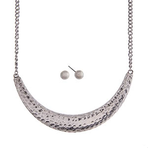 "Silver tone necklace set with a hammered crescent and stud earrings. Approximately 16"" in length."