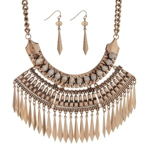 "Burnished gold tone statement necklace set with ivory beads and metal fringe detail. Approximately 16"" in length."