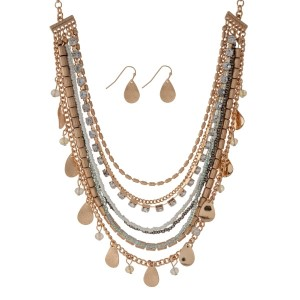 "Gold tone necklace set with gray and white beads and leaf charms, accented with clear rhinestones. Approximately 18"" in length."