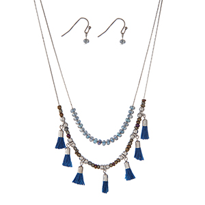 "Dainty silver tone double layer necklace set with blue beads and small blue tassels. Approximately 18"" in length."