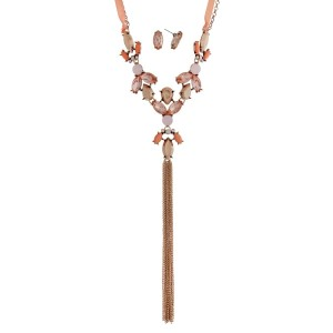 "Gold tone necklace set with peach rhinestones, a ribbon tie, and a chain tassel. Approximately 36"" in length."