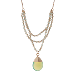 "Gold tone necklace with mint green beads and a  natural stone pendant. Approximately 30"" in length."