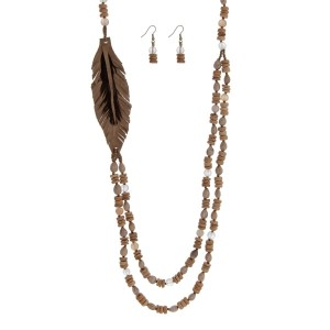 """Wooden beaded necklace with a leather feather focal and natural stone beaded accented. Made in the Philippines. Approximately 32"""" in length."""