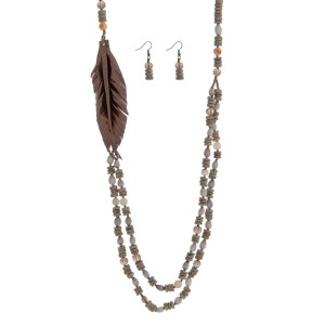 """Gray wooden beaded necklace with a leather feather focal and natural stone beaded accented. Made in the Philippines. Approximately 32"""" in length."""