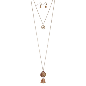 "Gold tone double layer necklace set with a filigree circle pendant and a peach beaded Marrakesh pendant. Approximately 34"" in length."