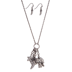 "Burnished silver tone necklace set with a charm cluster pendant featuring elephant, horn, star and flower charms. Approximately 30"" in length."
