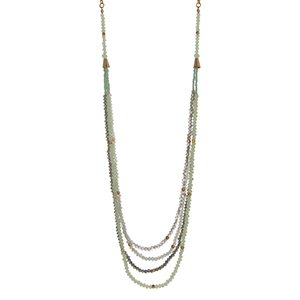 "Gold tone necklace with mint green, gray, and opal beads. Approximately 30"" in length."