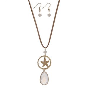 """Beige cord necklace set with a gold tone starfish and white opal pendant. Approximately 32"""" in length."""