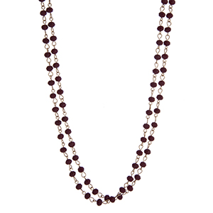 """Gold tone burgundy beaded wrap necklace. Approximately 60"""" in length."""