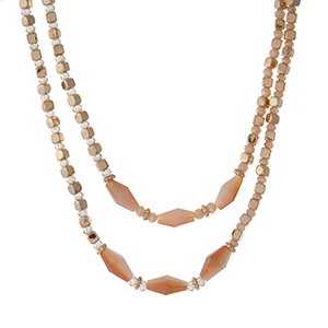 "Gold tone beaded necklace with champagne beads. Approximately 30"" in length."